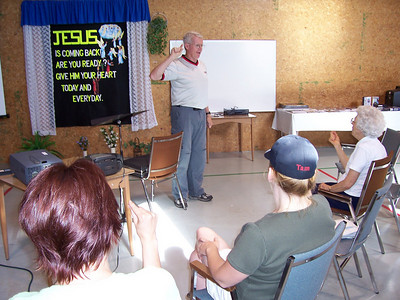 George Stothart teaching Sign Language to a group at a Camp Hope Deaf Ministry/Sign Language class