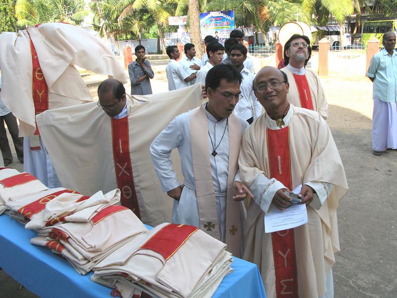 Vesting before the celebration, Fr. Guntoro (middle) and Fr. Kusmaryadi (right), (Indonesia)