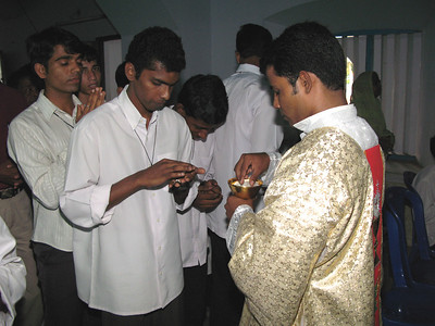 Deacon Jijo giving out communion.