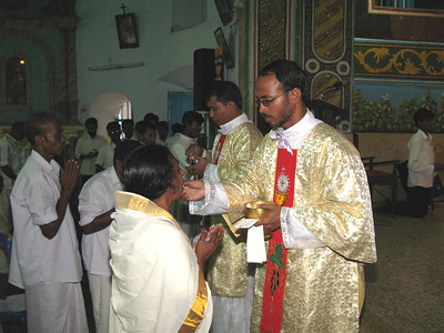 Deacon Aji giving out communion.
