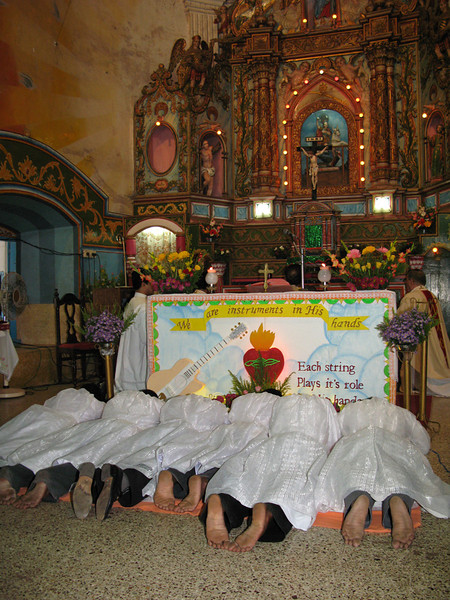 They lay prostrate during the singing of the Litany of Saints.