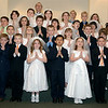 All the 1st Communion receivers with Father Bill in the back and Ms. Gnau, Dusty's teacher, right side in the back.