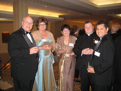Me (Larry Love); Mary Crumpler; Margaret Sutherland; Fr. Morgan White, our pastor; Luis Garza.  This was taken on Saturday evening, after Fr. White was promoted to Knight Commander of the Holy Sepulcher (KCHS).