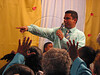 "Assembly of God pastor Dione dos Santos  preaches during a church service in a slum of Rio de Janeiro, Brazil. With most state functions absent in Rio's far of neighborhoods, the church pastor and the ""ministers""  find it easy to make converts of drug trafficker and others with their agressive recruitment campaign. (Australfoto/Douglas Engle)"