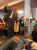 "An Assembly of God minister blesses church-goers , some on the floor, during a church service in a slum of Rio de Janeiro, Brazil. With most state functions absent in Rio's far of neighborhoods, the church pastor and the ""ministers""  find it easy to make converts of drug trafficker and others with their agressive recruitment campaign. (Australfoto/Douglas Engle)"