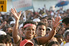 "Thousands attend an evangelical show on the Botafogo beach in Rio de Janeiro, Brazil, Feb. 4, 2006. Police said 300,000 people attended the service, called ""Show of Faith"" presented by Evangelical superstar missionary R. R. Soares. While Brazil, with 178 million people, is the world's largest Catholic country, Evangelical Protestants have made significant gains.  According to government figures, the percentage of Catholics fell from 84 percent in 1991 to 74 percent in 2000, while Evangelicals increased from 9 percent to 15 percent during the same period. Some predictions show evangelicals as half the population by 2050. The country's dire poverty explains part of the shift, with Brazil's tens of millions of poor looking for help to ease their misery after 500 years of Roman Catholic domination in the country. Another part of the evangelical appeal is theatrical, which plays well in Brazil.  Soares, who leads International Church of the Grace of God, has become the most the man who appears most on Brazilian television with some 100 hours per week on four free channels. (Australfoto/Douglas Engle)"