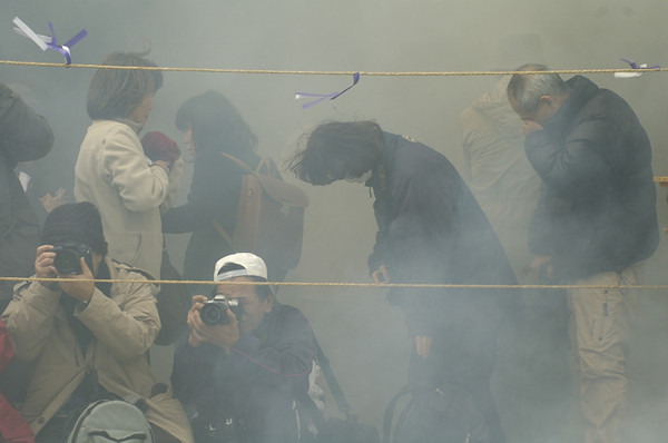 """For the sake of the shot."" Photographers literally sucking in the smoke while they keep on shooting. That is Dedication."