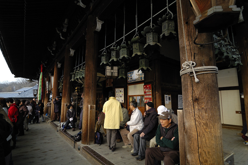 The veranda on the main level of Nigatsudo. The seated men are photographers and the faithful waiting for dusk, and the start of the event. I may be mistaken, but I think women are prevented from this area during the ritual.