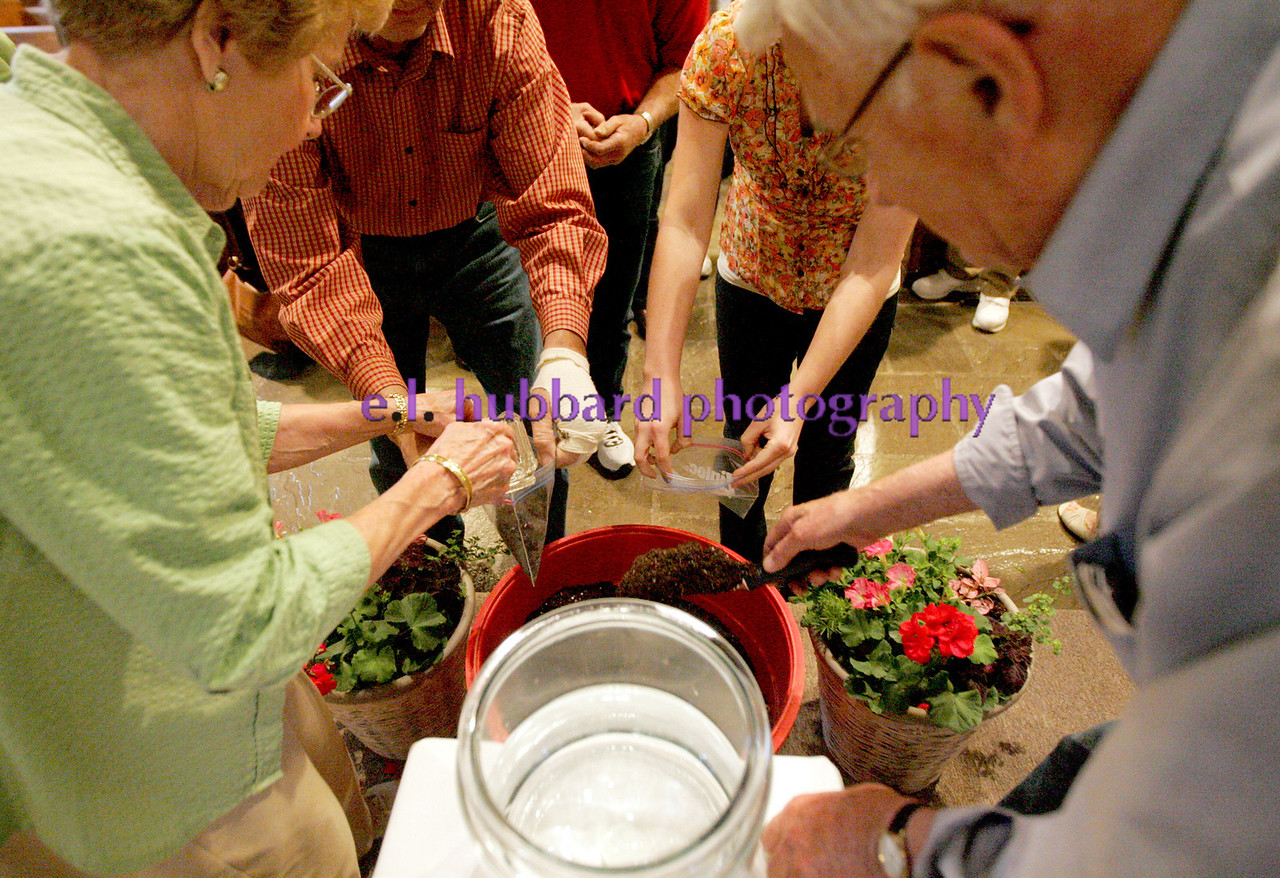 E.L. Hubbard Photography<br /> Ray and Mary Ann DeLoye dispense the Blessed soil and water after the Farm Mass. The annual Farm Mass was held at Sts. Peter and Paul Church in Newport, Ohio Friday, May 15. The Mass was held indoors because of the fear of inclement weather.
