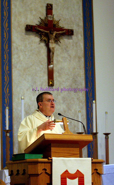 E.L. Hubbard Photography<br /> Fr. Steven Shoup during the Farm Mass. The annual Farm Mass was held at Sts. Peter and Paul Church in Newport, Ohio Friday, May 15. The Mass was held indoors because of the fear of inclement weather.