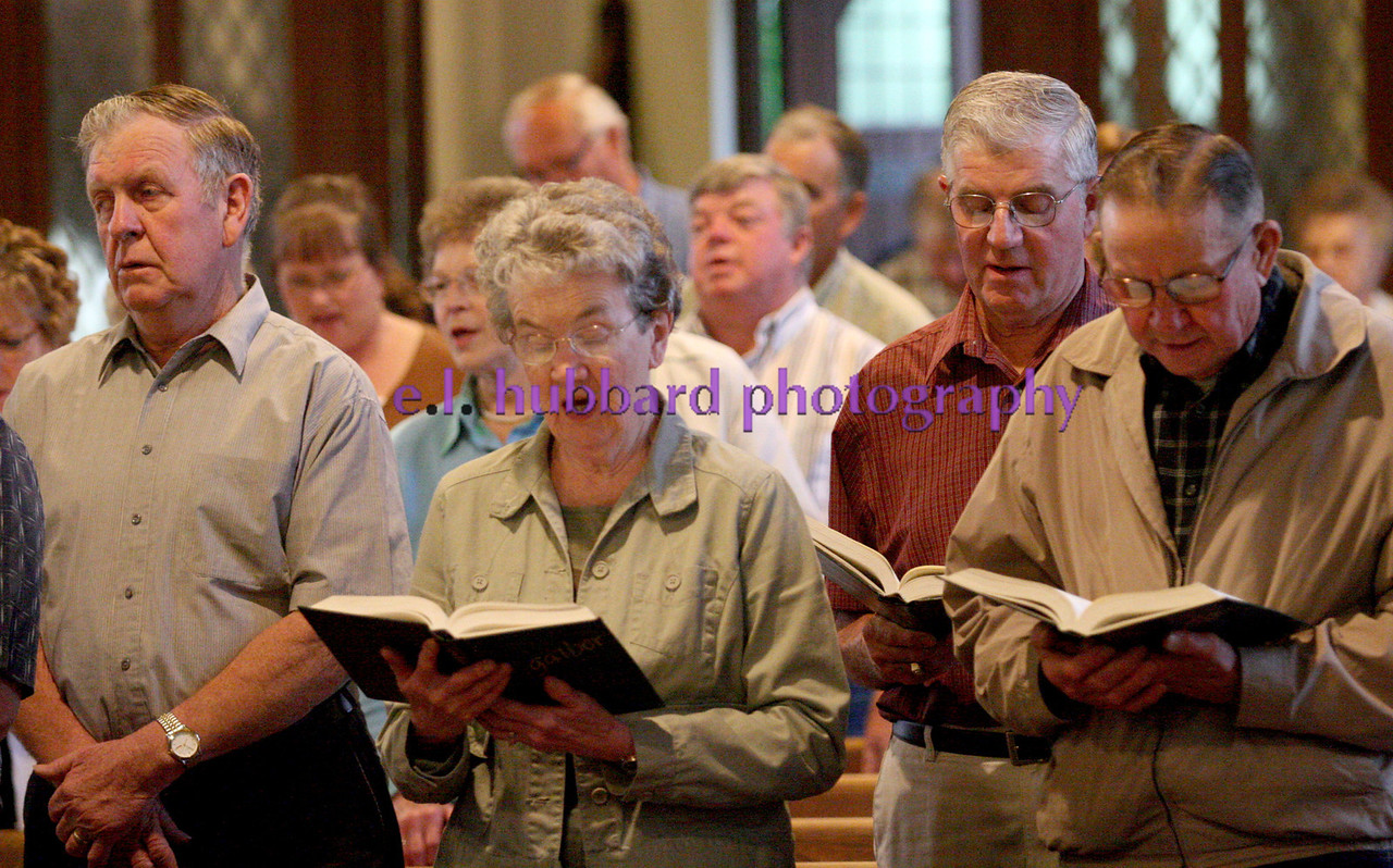 E.L. Hubbard Photography<br /> Parishoners sing during Mass. The annual Farm Mass was held at Sts. Peter and Paul Church in Newport, Ohio Friday, May 15. The Mass was held indoors because of the fear of inclement weather.