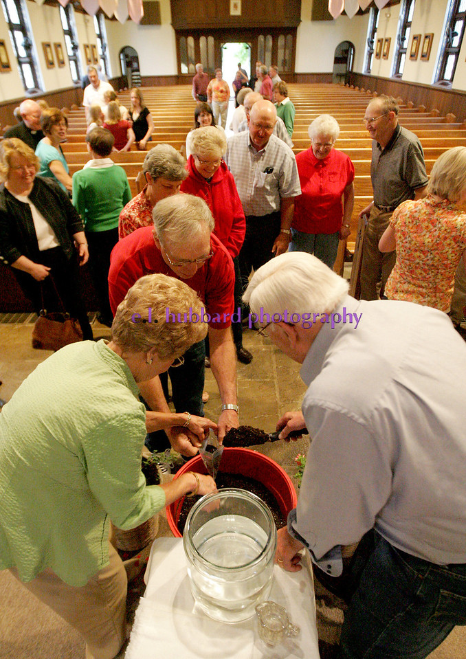 .E.L. Hubbard Photography<br /> Ray and Mary Ann DeLoye dispense the Blessed soil and water after the Farm Mass. The annual Farm Mass was held at Sts. Peter and Paul Church in Newport, Ohio Friday, May 15. The Mass was held indoors because of the fear of inclement weather.