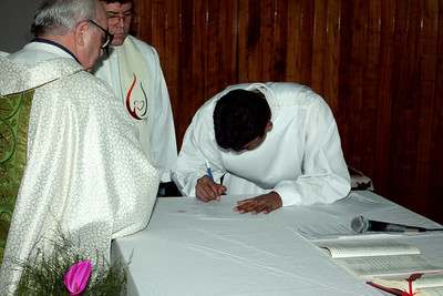 Signing the written statement of his Final Vows.