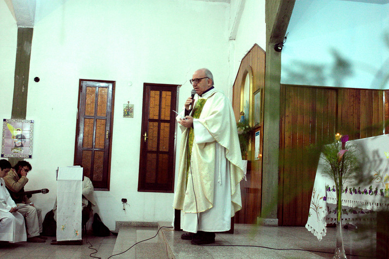 Fr. Attilio, SCJ gives the homily / instruction before the taking of Final Vows.
