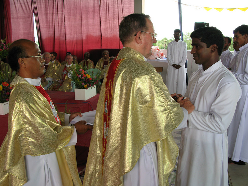 Br. Sanil receives his profession cross.