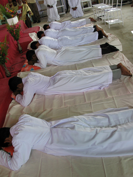 Before professing their vows they lay prostrate during the singing of the Litany of Saints.