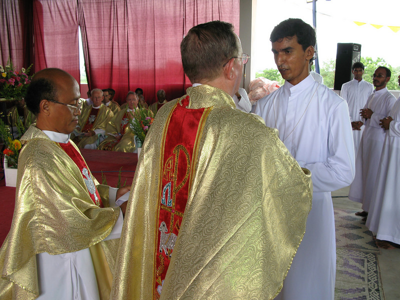 Br. Michael receives his profession cross.