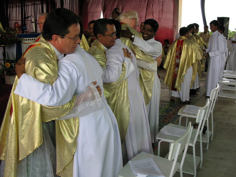 The finally professed are congratulated by fellow SCJs.
