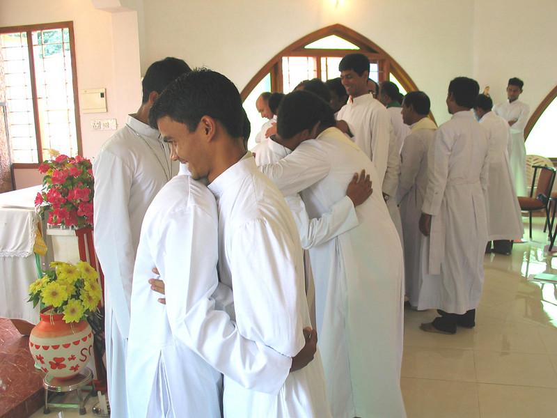 Fellow SCJs approach the newly professed to congratulate them.