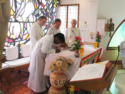 Each of the newly professed now sign the book of records, indicating the profession, with witnesses.