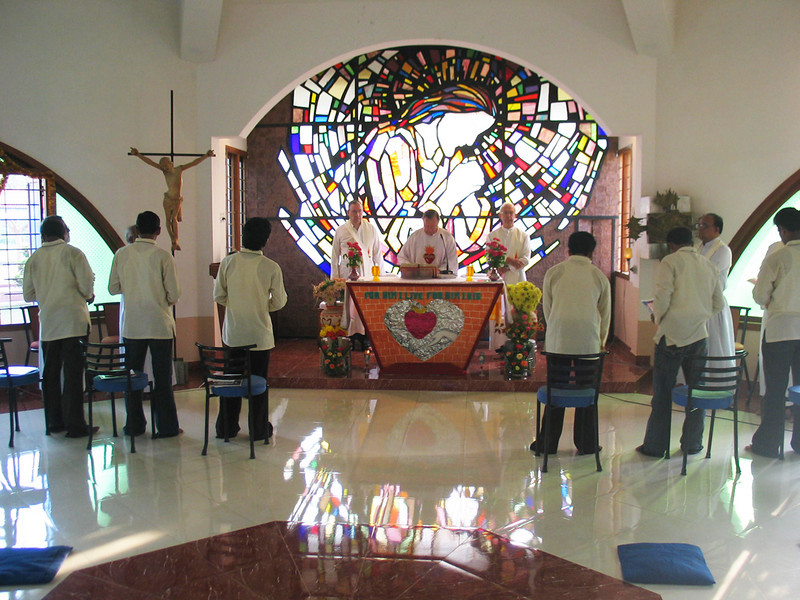 The Celebration of the Eucharist begins.  Fr. Martin SCJ(District Superior) is the main celebrant.  Fr. Tom Stanley SCJ(L) is the Novice Master.  Fr. Tom Fix SCJ(R) from Indonesia, and the six novices, standing, who will take their First Vows