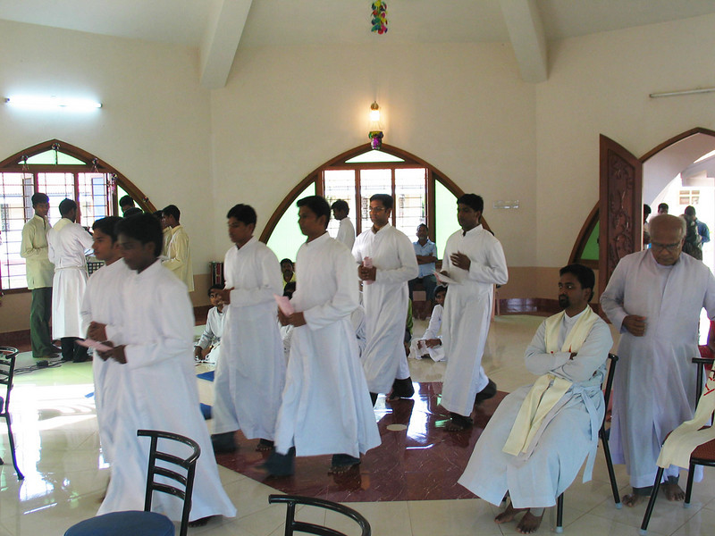 The novices return to the chapel wearing their cassocks.