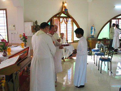 Each of the newly professed is presented with a bible.