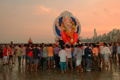 Even as the day comes to an end, stream of people doesn't reduce as Mumbai celebrates the birthday of Lord Ganesha which is one of the most popular Hindu festivals.  Ganesh Chaturthi [Birthday Of Lord Ganesh] being celebrated by the immersion of Ganesh idols in the Chowpatty beach, Mumbai, India.