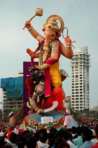 Ganesh Chaturthi [Birthday Of Lord Ganesh] being celebrated by the immersion of Ganesh idols in the Chowpatty beach, Mumbai, India. The birthday of Lord Ganesha is one of the most popular Hindu festivals.