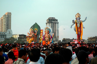 Ganesh Chaturthi [Birthday Of Lord Ganesh] being celebrated by the immersion of Ganesh idols in the Chowpatty beach, Mumbai, India. Multiple idols - big and small are immersed into the Arabian sea at Chowpatty near Marine Lines (Girgaon). The birthday of Lord Ganesha is one of the most popular Hindu festivals.