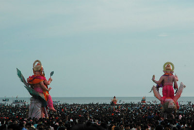 The beach, sand and the shoreline is hardly visible with the sea of humanity.  Ganesh Chaturthi [Birthday Of Lord Ganesh] being celebrated by the immersion of Ganesh idols in the Chowpatty beach, Mumbai, India.