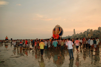 Even as the day comes to an end, stream of people doesn't reduce at all.  Ganesh Chaturthi [Birthday Of Lord Ganesh] being celebrated by the immersion of Ganesh idols in the Chowpatty beach, Mumbai, India.