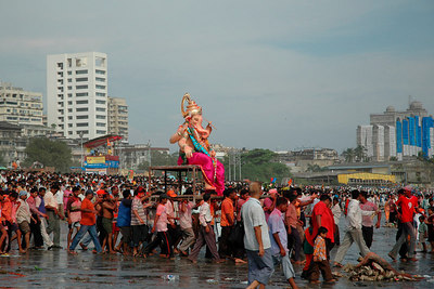 Ganesh Chaturthi [Birthday Of Lord Ganesh] being celebrated by the immersion of Ganesh idols in the Chowpatty beach, Mumbai, India.