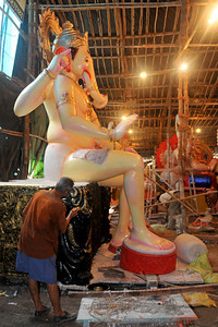 Artists at Railway grounds, Lower Parel in Mumbai make Ganesh idols and paint them with rich colours on the eve of the Ganesh Chaturti festival.