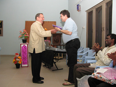 Fr. Martin presents a gift to Fr. Pedro.