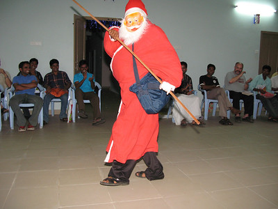 After the various song, dance, and skit performances, Santa Claus announces the time for the exchanging of gifts.