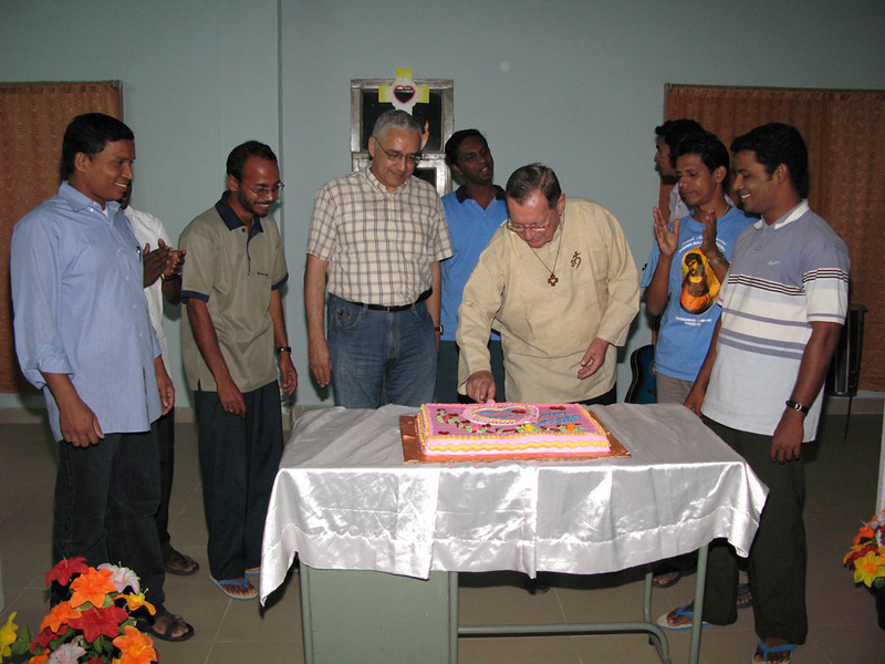Fr. Martin cuts the cake at the beginning of the community gathering.
