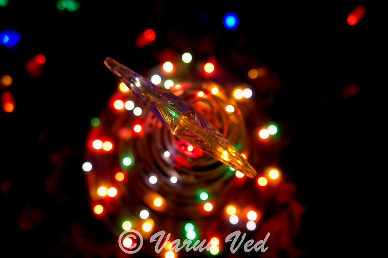 In this picture, i wanted to blur out the the lights, and focus on the star on this outdoor Christmas decoration.