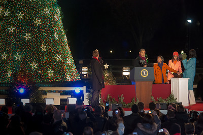 First daughter Sasha Obama (third from left) has just pushed the button to light the National Christmas Tree. President Barack Obama, joined by the First Lady, their two daughters, Sasha and Malia, and the First Grandmother appeared before an estimated crowd of 17,000 on the Ellipse, just south of the White House in Washington D.C. on December 6, 2012 for the 90th annual tree lighting ceremony. TV star Neil Patrick Harris (left) hosted the event. (Photo by Jeff Malet)