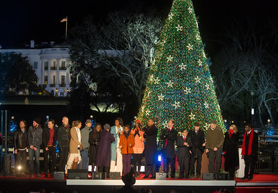"President Obama appears onstage with entertainers at the 90th annual National Christmas Tree Lighting Ceremony on the Ellipse, just south of the White House in Washington D.C. on December 6, 2012. Left to right in photo, 4 members of The Fray, Colbie Caillat, Jason Mraz, Ledisi, Michelle, Sasha, Malia and Barack Obama, Neil Patrick Harris, Rico Rodriguez, Phillip Phillips, James Taylor and Kenny ""Baby Face"" Edmonds. (Photo by Jeff Malet)"