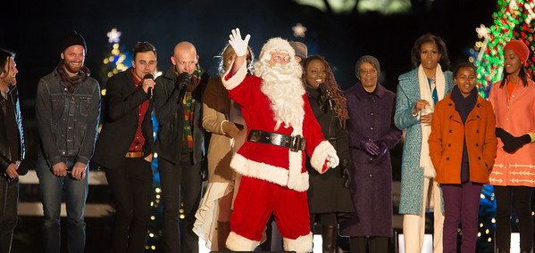 The First Family appears onstage with Santa and entertainers at the 90th annual National Christmas Tree Lighting Ceremony on the Ellipse, just south of the White House in Washington D.C. on December 6, 2012. Left to right in photo, members of The Fray, Colbie Caillat, Jason Mraz, Ledisi, mother-in-law Marian Robinson, Michelle, Sasha and Malia Obama. (Photo by Jeff Malet)