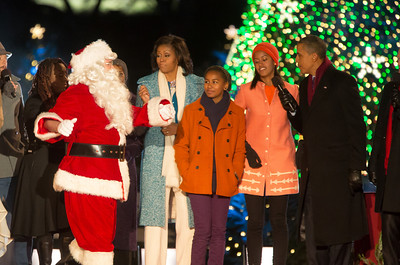 The First Family appears onstage with Santa and entertainers at the 90th annual National Christmas Tree Lighting Ceremony on the Ellipse, just south of the White House in Washington D.C. on December 6, 2012. Left to right in photo, Santa Claus, Michelle, Sasha, Malia and President Barack Obama. (Photo by Jeff Malet)
