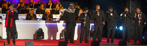 """Singer, songwriter and producer Kenny """"Babyface"""" Edmonds (left) entertains at the 90th annual lighting of the National Christmas Tree. President Barack Obama and the First Family flicked the switch to light up the tree before an estimated crowd of 17,000 on the Ellipse, south of the White House in Washington D.C. on December 6, 2012.  (Photo by Jeff Malet)"""