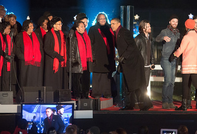 Members of the Washington Performing Arts Society gospel choir were greeted by President Obama at the end of the 90th annual lighting of the National Christmas Tree. President Barack Obama and the First Family flicked the switch to light up the tree before an estimated crowd of 17,000 on the Ellipse, near the White House in Washington D.C. on December 6, 2012  (Photo by Jeff Malet)