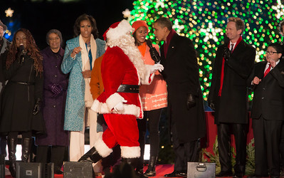 President Barack Obama and The First Family appear onstage with Santa and entertainers at the conclusion of the 90th annual National Christmas Tree Lighting Ceremony on the Ellipse, just south of the White House in Washington D.C. on December 6, 2012. (Photo by Jeff Malet)