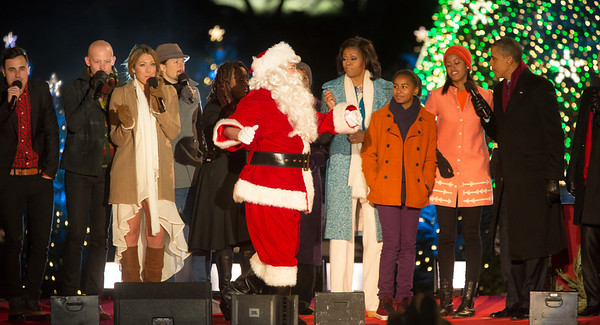 The First Family appears onstage with Santa and entertainers at the 90th annual National Christmas Tree Lighting Ceremony on the Ellipse, just south of the White House in Washington D.C. on December 6, 2012. Left to right in photo,The Fray, Colbie Caillat, mother-in-law Marian Robinson, Michelle, Sasha, Malia and President Barack Obama. (Photo by Jeff Malet)