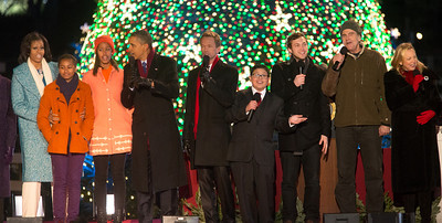 President Obama appears onstage with entertainers at the 90th annual National Christmas Tree Lighting Ceremony on the Ellipse, just south of the White House in Washington D.C. on December 6, 2012. Left to right in photo, MIchelle, Sasha, Malia and Barack Obama, Rico Rodriguez, Phillip Phillips, James Taylor. (Photo by Jeff Malet)