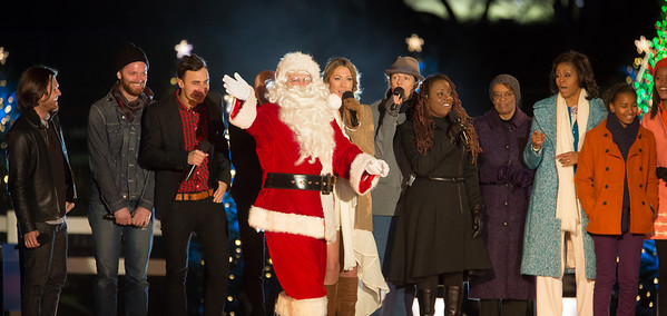 The First Family appears onstage with Santa and entertainers at the 90th annual National Christmas Tree Lighting Ceremony on the Ellipse, just south of the White House in Washington D.C. on December 6, 2012. Left to right in photo, members of The Fray, Colbie Caillat, Jason Mraz, Ledisi, mother-in-law Marian Robinson, Michelle, Sasha Obama. (Photo by Jeff Malet)
