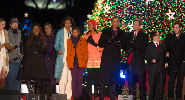 President Obama appears onstage with entertainers at the 90th annual National Christmas Tree Lighting Ceremony on the Ellipse, just south of the White House in Washington D.C. on December 6, 2012. Left to right in photo, Colbie Caillat, Jason Mraz, Ledisi, Michelle, Sasha, Malia and Barack Obama, Neil Patrick Harris, Rico Rodriguez, Phillip Phillips. (Photo by Jeff Malet)