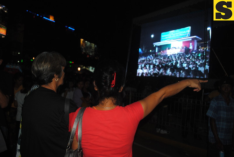 Some of the members of Iglesia ni Cristo (INC) who joined the evangelical mission watched the activities inside the Fuente Osmena Circle through a projected widescreen.